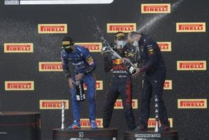 Lando Norris, McLaren, 3rd position, Max Verstappen, Red Bull Racing, 1st position, and the Red Bull trophy delegate celebrate with Chamapagne