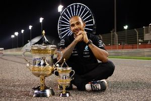 Lewis Hamilton, Mercedes, 1st position, with the trophies