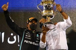 Lewis Hamilton, Mercedes, 1st position, on the podium with his team mate and the Constructors trophy