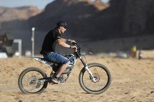 Sebastien Loeb, X44, rides an LMX motorbike