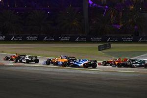 Pierre Gasly, AlphaTauri AT02, Daniel Ricciardo, McLaren MCL35M, and Lando Norris, McLaren MCL35M