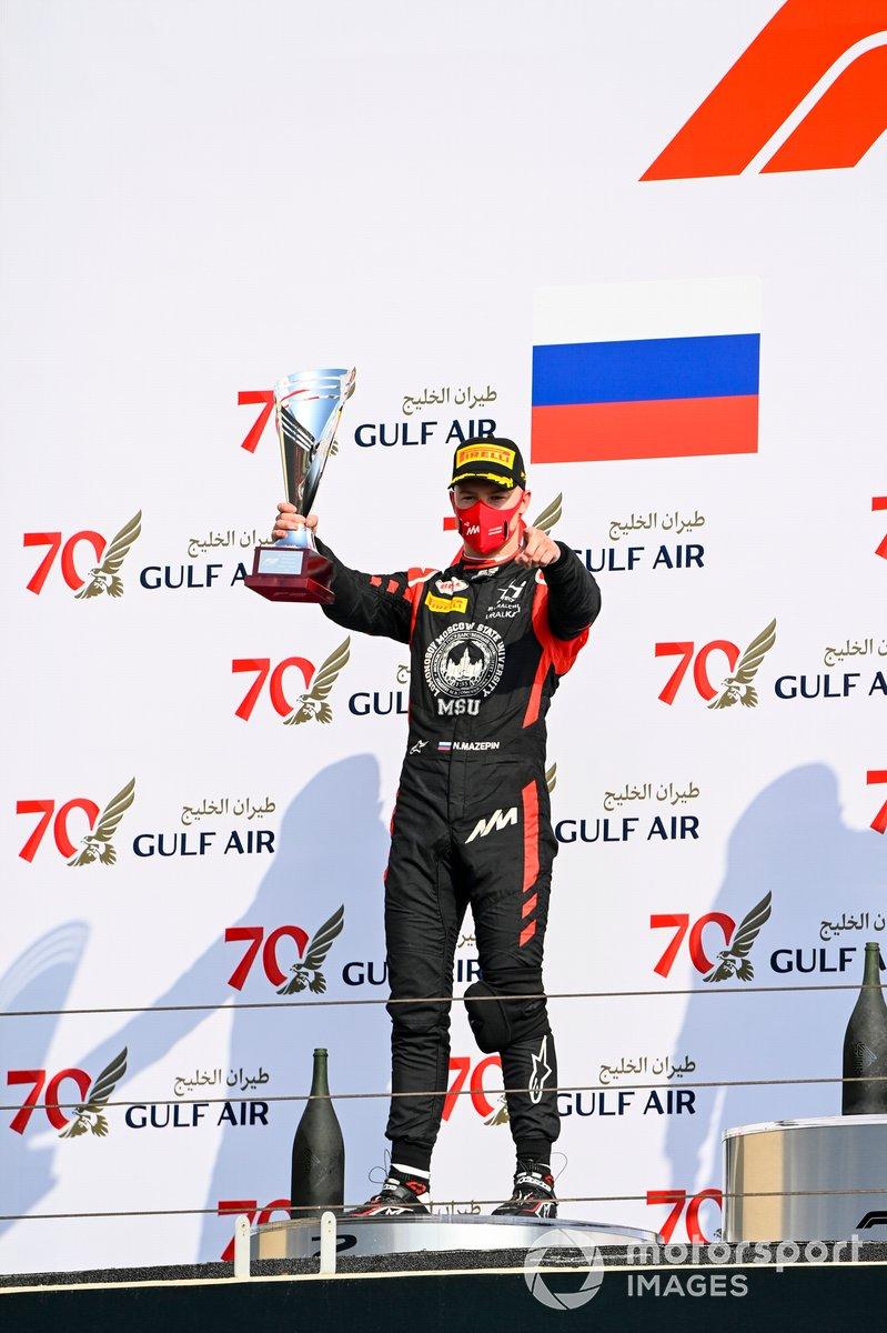 Nikita Mazepin, Hitech Grand Prix celebrates on the podium with the trophy