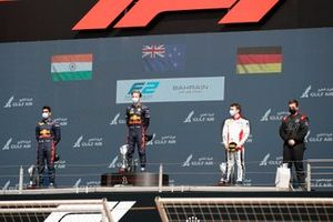 Jehan Daruvala, Carlin, 2nd position, Liam Lawson, Hitech Grand Prix, 1st position, and David Beckmann, Charouz Racing System, 3rd position, on the podium