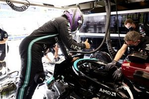 Lewis Hamilton, Mercedes W12, climbs into his car