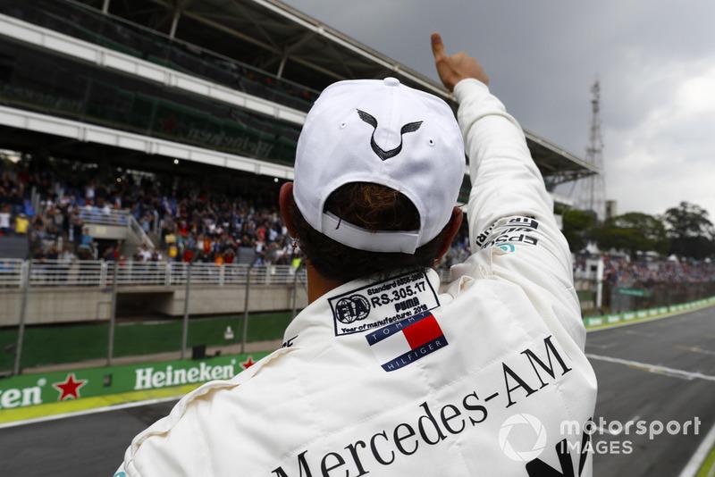 Lewis Hamilton, Mercedes AMG F1, celebrates taking pole position.