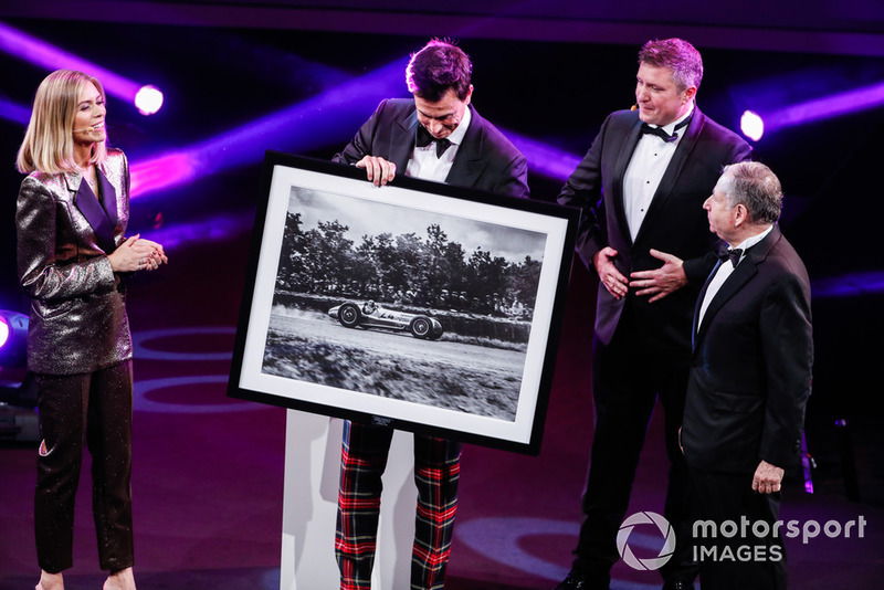 Toto Wolff is presented with a framed photo of a Mercedes Grand Prix car