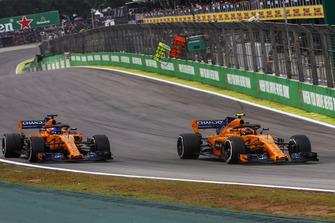 Stoffel Vandoorne, McLaren MCL33, passes Fernando Alonso, McLaren MCL33
