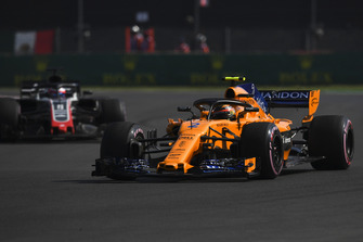 Stoffel Vandoorne, McLaren MCL33 and Romain Grosjean, Haas F1 Team VF-18