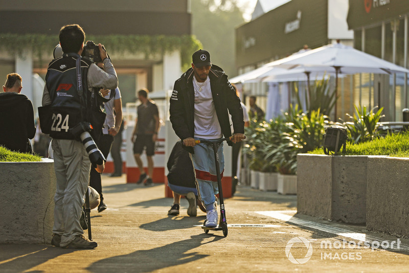 Lewis Hamilton, Mercedes AMG F1, rides his scooter through the paddock