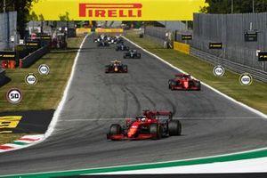 Charles Leclerc, Ferrari SF21, Carlos Sainz Jr., Ferrari SF21, and Sergio Perez, Red Bull Racing RB16B