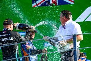 Valtteri Bottas, Mercedes, 3rd position, Daniel Ricciardo, McLaren, 1st position, and Zak Brown, CEO, McLaren Racing, battle with Champagne on the podium