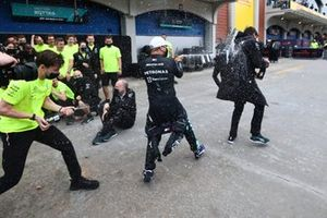 Valtteri Bottas, Mercedes, 1st position, sprays Toto Wolff, Team Principal and CEO, Mercedes AMG, with Champagne