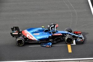 Esteban Ocon, Alpine F1, stops on the grid at the end of FP2 with technical issues