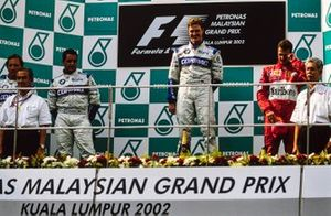 Podium: race winner Ralf Schumacher, Williams, second place Juan Pablo Montoya, Williams, third place Michael Schumacher, Ferrari