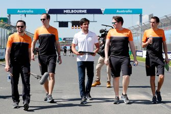 Carlos Sainz Jr., McLaren walks the track with members of the team