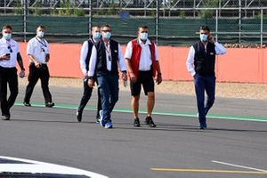 Michael Masi, Race Director walks the track with FIA personnel
