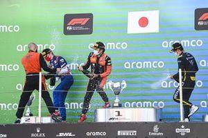 Robert Shwartzman, Prema Racing, 2nd position, Nobuharu Matsushita, MP Motorsport, 1st position, and Guanyu Zhou, UNI-VIRTUOSI, 3rd position, celebrate with Champagne on the podium