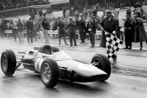 Jim Clark, Lotus 25 Climax, takes the chequered flag