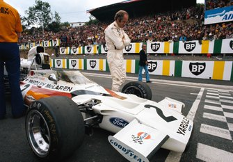 Denny Hulme alongside his McLaren M19C Ford on the grid