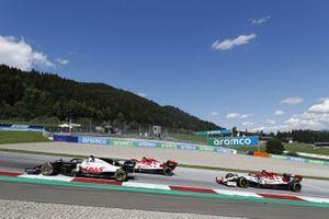 Romain Grosjean, Haas VF-20, leads Antonio Giovinazzi, Alfa Romeo Racing C39, and Kimi Raikkonen, Alfa Romeo Racing C39