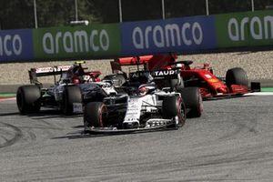 Daniil Kvyat, AlphaTauri AT01, leads Sebastian Vettel, Ferrari SF1000, and Antonio Giovinazzi, Alfa Romeo Racing C39