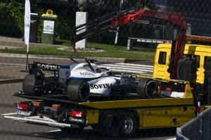 The car of George Russell, Williams FW43, is returned to the garage on a truck