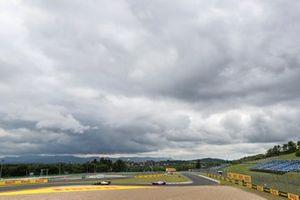 Romain Grosjean, Haas VF-20, leads Lance Stroll, Racing Point RP20