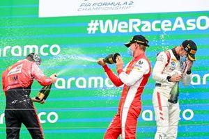 Callum Ilott, UNI-Virtuosi, Race Winner Luca Ghiotto, Hitech Grand Prix and Mick Schumacher, Prema Racing celebrate on the podium