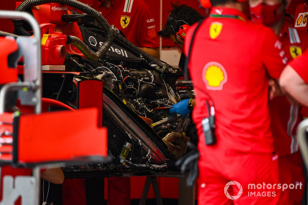 Ferrari mechnanics at work in the team's garage and SF1000 engine detail