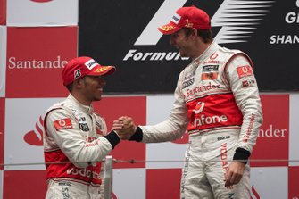 Podium: race winner Jenson Button, McLaren, second place Lewis Hamilton, McLaren