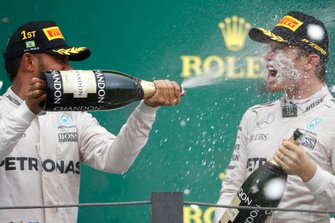 Race winner Lewis Hamilton, Mercedes AMG F1, sprays the champagne in Nico Rosberg, Mercedes AMG F1