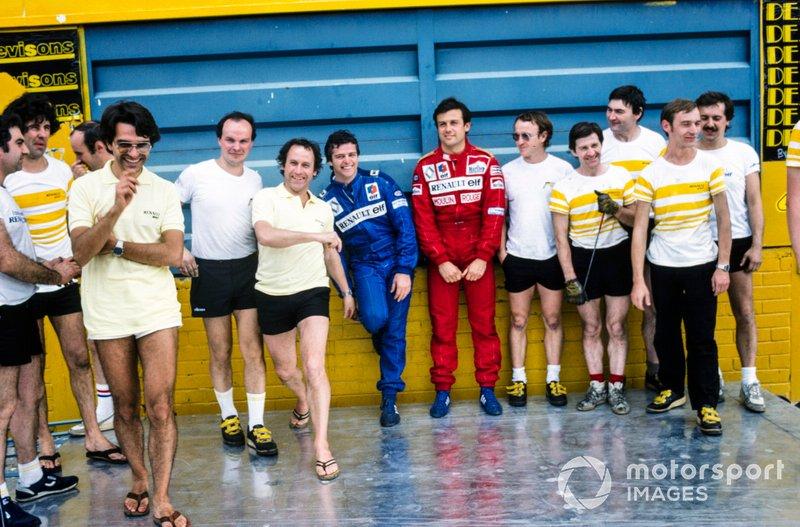 Patrick Tambay and Derek Warwick with Renault team members