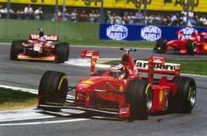 Michael Schumacher, Ferrari F300, Jacques Villeneuve, Williams FW20 Mecachrome, and Eddie Irvine, Ferrari F300