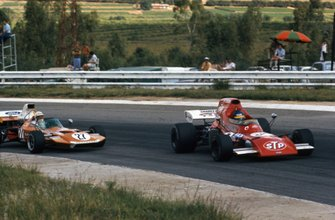 Ronnie Peterson, March 721 Ford leads John Love, Surtees TS9 Ford
