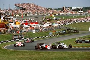 Keke Rosberg, Williams FW08C Ford, leads Mauro Baldi, Alfa Romeo 183T, Niki Lauda, McLaren MP4-1C Ford, and Bruno Giacomelli, Toleman TG183B Hart