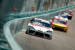 Harrison Burton, Joe Gibbs Racing Toyota, leads a pack of cars