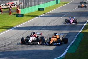 Kimi Raikkonen, Alfa Romeo Racing C39 and Carlos Sainz Jr., McLaren MCL35 go side by side