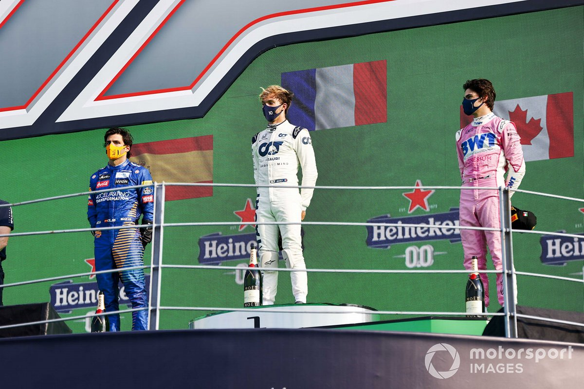 Carlos Sainz Jr., McLaren, 2nd position, Pierre Gasly, AlphaTauri, 1st position, and Lance Stroll, Racing Point, 3rd position, on the podium