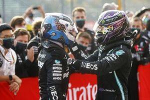 Lewis Hamilton, Mercedes-AMG F1, celebrates victory in parc ferme with Valtteri Bottas, Mercedes-AMG F1