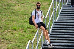 Romain Grosjean, Haas F1 slides down the handrail on his way into the circuit