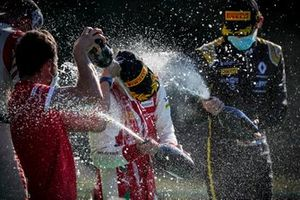 Christian Lundgaard, ART Grand Prix and Race winner Mick Schumacher, Prema Racing celebrate on the podium with the champagne