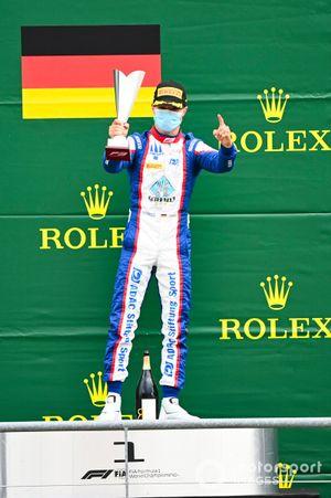 Race Winner Lirim Zendeli, Trident celebrates on the podium with the trophy