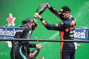 Max Verstappen, Red Bull Racing, 3rd position, pours Champagne over Lewis Hamilton, Mercedes-AMG F1, 1st position, on the podium