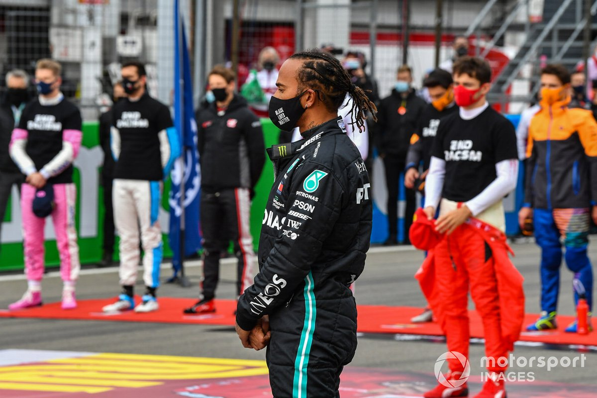 Lewis Hamilton, Mercedes-AMG F1, and the other drivers stand on the grid