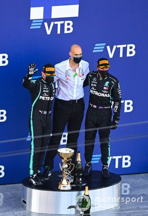 Valtteri Bottas, Mercedes-AMG F1, 1st position, the Mercedes trophy delegate and Lewis Hamilton, Mercedes-AMG F1, 3rd position, on the podium
