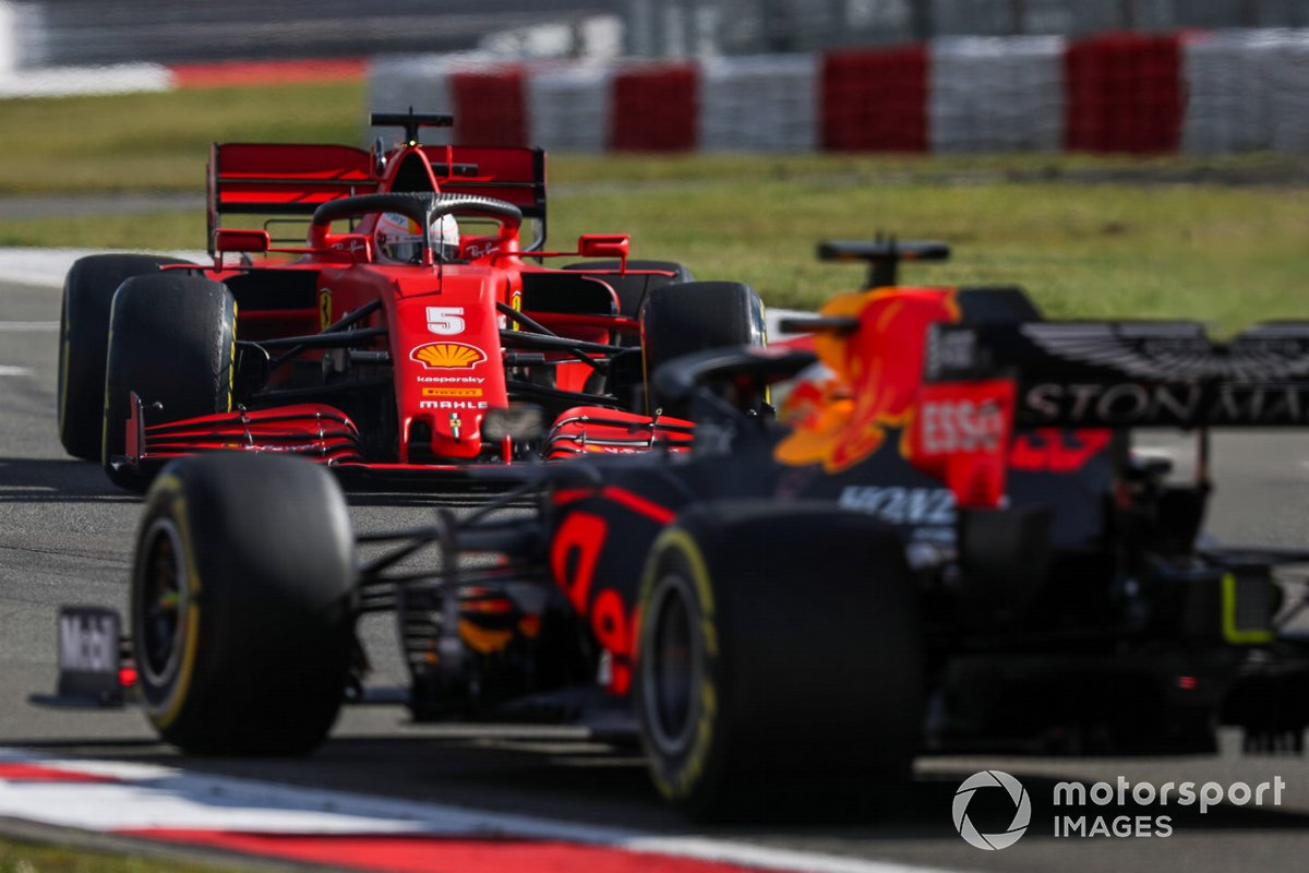 Sebastian Vettel, Ferrari SF1000, suffers a spin ahead of Max Verstappen, Red Bull Racing RB16