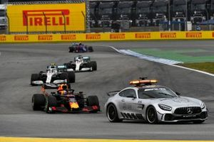 The Safety Car leads Max Verstappen, Red Bull Racing RB15, Valtteri Bottas, Mercedes AMG W10, and Lewis Hamilton, Mercedes AMG F1 W10