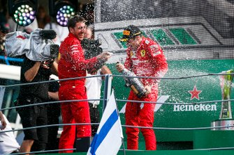 Matteo Togninalli, Head of Track Engineering, Ferrari, and Charles Leclerc, Ferrari, 1st position, celebrate on the podium