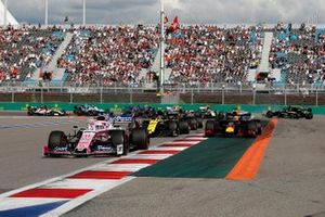 Sergio Perez, Racing Point RP19, leads Nico Hulkenberg, Renault F1 Team R.S. 19, Max Verstappen, Red Bull Racing RB15, and the remainder of the field as Daniel Ricciardo, Renault F1 Team R.S.19, collides with Antonio Giovinazzi, Alfa Romeo Racing C38, and Romain Grosjean, Haas F1 Team VF-19