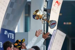 Winner Lewis Hamilton, Mercedes AMG F1, throws his trophy in the air on the podium
